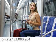 Купить «Woman with headphones in subway», фото № 33000264, снято 19 сентября 2018 г. (c) Яков Филимонов / Фотобанк Лори
