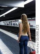 Купить «Woman on underground platform waiting train», фото № 33000272, снято 19 сентября 2018 г. (c) Яков Филимонов / Фотобанк Лори