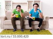 Купить «Friends watching football at home», фото № 33000420, снято 5 февраля 2019 г. (c) Elnur / Фотобанк Лори