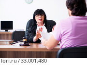 Купить «Young man consulting with judge on litigation issue», фото № 33001480, снято 6 мая 2019 г. (c) Elnur / Фотобанк Лори