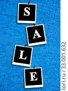 Inscription sale on the blue fabric. Стоковое фото, фотограф Александр Птах / Фотобанк Лори