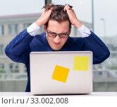 Купить «Workaholic businessman overworked with too much work in office», фото № 33002008, снято 11 октября 2016 г. (c) Elnur / Фотобанк Лори
