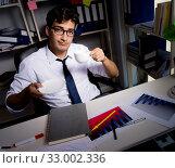 Купить «Man businessman working late hours in the office», фото № 33002336, снято 3 августа 2017 г. (c) Elnur / Фотобанк Лори