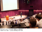 Купить «Speaker giving presentation on business conference event.», фото № 33002816, снято 18 октября 2019 г. (c) Matej Kastelic / Фотобанк Лори