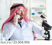 Купить «Arab chemist scientist testing quality of oil petrol», фото № 33004956, снято 21 апреля 2018 г. (c) Elnur / Фотобанк Лори