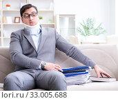 Купить «Man in neck brace cervical collar working from home teleworking», фото № 33005688, снято 16 мая 2017 г. (c) Elnur / Фотобанк Лори
