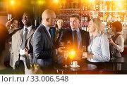 Men and woman at corporate party. Стоковое фото, фотограф Яков Филимонов / Фотобанк Лори