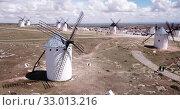 Купить «Picturesque rural landscape of Campo de Criptana with traditional windmills in sunny day, Spain», видеоролик № 33013216, снято 23 апреля 2019 г. (c) Яков Филимонов / Фотобанк Лори