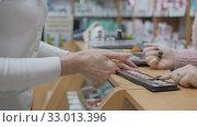 Buying cosmetics in the store. Woman Choosing color cosmetics in the store. Woman uses makeup tester. Стоковое видео, видеограф Константин Мерцалов / Фотобанк Лори
