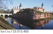 Купить «View of medieval castle in Belarusian city Nyasvizh on winter day, Minsk region», видеоролик № 33013400, снято 9 апреля 2020 г. (c) Яков Филимонов / Фотобанк Лори