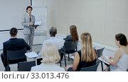 Купить «Businessman making presentation on staff meeting at office», видеоролик № 33013476, снято 20 февраля 2020 г. (c) Яков Филимонов / Фотобанк Лори