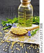Семя льняное белое в ложке с маслом на доске. Стоковое фото, фотограф Резеда Костылева / Фотобанк Лори