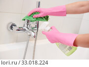 cleaning service. wiping bathroom faucet tap. Стоковое фото, фотограф Дмитрий Калиновский / Фотобанк Лори