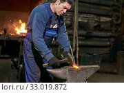 Aged male blacksmith at work. Стоковое фото, фотограф Евгений Харитонов / Фотобанк Лори