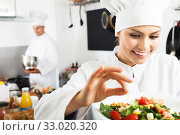 Female chef preparing fresh salad. Стоковое фото, фотограф Яков Филимонов / Фотобанк Лори