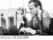 Купить «Business people in modern office against new york city manhattan buildings and skyscrapers window reflections.», фото № 33020888, снято 9 июля 2020 г. (c) Matej Kastelic / Фотобанк Лори