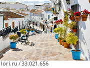 Купить «Idyllic scene picturesque street small white-washed village of Mijas. Path way decorated with hanging on houses walls plants in bright flowerpots, famous place Costa del Sol, Andalusia, Málaga, Spain», фото № 33021656, снято 17 декабря 2019 г. (c) Alexander Tihonovs / Фотобанк Лори
