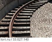 Купить «Grungy turning rail on dark wooden sleepers», фото № 33027140, снято 29 июня 2019 г. (c) EugeneSergeev / Фотобанк Лори