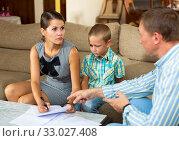 Купить «Woman with preteen son signing apartment lease», фото № 33027408, снято 5 июня 2020 г. (c) Яков Филимонов / Фотобанк Лори