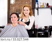 Купить «Woman consults with a young hairdresser», фото № 33027544, снято 7 марта 2017 г. (c) Яков Филимонов / Фотобанк Лори