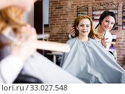 Купить «Woman consults with master in hairdress», фото № 33027548, снято 7 марта 2017 г. (c) Яков Филимонов / Фотобанк Лори