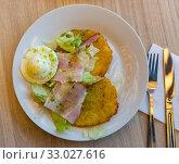 Купить «Draniki (potato pancakes) with ham, fried egg», фото № 33027616, снято 1 апреля 2020 г. (c) Яков Филимонов / Фотобанк Лори