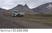 Купить «HINO-700 Japanese dump truck Hino Motors Ltd. Toyota Group Company transporting cargo from construction site at foot of volcano», видеоролик № 33028908, снято 30 августа 2019 г. (c) А. А. Пирагис / Фотобанк Лори