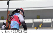 Sportswoman biathlete aiming, rifle shooting in prone position. Biathlete Choi Yoonah South Korea in shooting range. Junior biathlon competitions East of Cup (2019 год). Редакционное видео, видеограф А. А. Пирагис / Фотобанк Лори