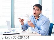Купить «Male call-center operator in business concept», фото № 33029104, снято 26 марта 2018 г. (c) Elnur / Фотобанк Лори