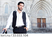 Waist up portrait of man near iron railings. Стоковое фото, фотограф Яков Филимонов / Фотобанк Лори