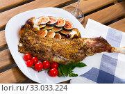 Купить «Tasty baked shoulder of lamb with cherry tomatoes, fig, feta cheese and herbs», фото № 33033224, снято 25 февраля 2020 г. (c) Яков Филимонов / Фотобанк Лори