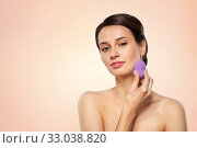 Купить «young woman with sponge applying makeup», фото № 33038820, снято 30 ноября 2019 г. (c) Syda Productions / Фотобанк Лори