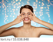 Купить «beautiful young woman touching her face», фото № 33038848, снято 30 ноября 2019 г. (c) Syda Productions / Фотобанк Лори