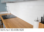 Купить «modern home kitchen interior with oven and hob», фото № 33038920, снято 15 октября 2019 г. (c) Syda Productions / Фотобанк Лори