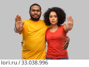 Купить «african american couple showing stop gesture», фото № 33038996, снято 15 декабря 2019 г. (c) Syda Productions / Фотобанк Лори