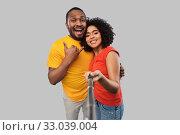 Купить «african couple taking picture by selfie stick», фото № 33039004, снято 15 декабря 2019 г. (c) Syda Productions / Фотобанк Лори