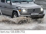 Купить «Mercedes-Benz G-Wagen driving on flooded street road over deep muddy puddle», фото № 33039772, снято 18 августа 2018 г. (c) А. А. Пирагис / Фотобанк Лори