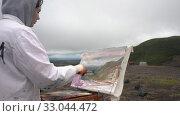 Купить «Girl artist draws brush oil painting autumn landscape of mountains during gloomy cloudy weather», видеоролик № 33044472, снято 30 августа 2019 г. (c) А. А. Пирагис / Фотобанк Лори