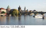 View of Prague, Charles bridge and the Vltava river with tourist boats floating. Czech republic. Стоковое видео, видеограф Яков Филимонов / Фотобанк Лори