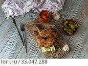 Купить «Fried chicken legs on a cutting board close-up», фото № 33047288, снято 5 февраля 2020 г. (c) Татьяна Ляпи / Фотобанк Лори