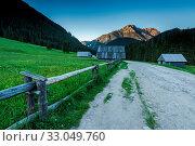 Chocholowska Valley wooden cabin at dusk in Tatra National Park, Poland. Стоковое фото, фотограф Zoonar.com/Mjucha / easy Fotostock / Фотобанк Лори