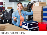Купить «girl choosing shoes», фото № 33051140, снято 15 сентября 2016 г. (c) Яков Филимонов / Фотобанк Лори