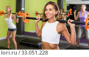 athletic girls during workout in gym with barbell. Стоковое фото, фотограф Яков Филимонов / Фотобанк Лори