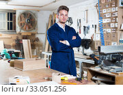 Young male joiner standing at his workplace. Стоковое фото, фотограф Яков Филимонов / Фотобанк Лори
