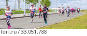 Купить «Russia, Samara, May 2019: a group of young beautiful sports people run around the new stadium at a city event, race.», фото № 33051788, снято 19 мая 2019 г. (c) Акиньшин Владимир / Фотобанк Лори