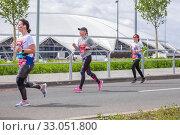 Купить «Russia, Samara, May 2019: a group of young beautiful sports people run around the new stadium at a city event, race.», фото № 33051800, снято 19 мая 2019 г. (c) Акиньшин Владимир / Фотобанк Лори
