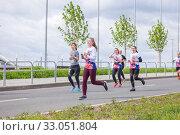 Купить «Russia, Samara, May 2019: a group of young beautiful sports people run around the new stadium at a city event, race.», фото № 33051804, снято 19 мая 2019 г. (c) Акиньшин Владимир / Фотобанк Лори