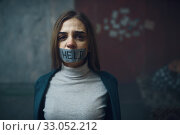 Купить «Victim with her mouth taped shut, kidnapping», фото № 33052212, снято 13 ноября 2019 г. (c) Tryapitsyn Sergiy / Фотобанк Лори