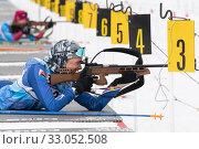 Купить «Kamchatka sportswoman biathlete Soldatova Arina rifle shooting in prone position. Biathlete in shooting range of Junior biathlon competitions East Cup», фото № 33052508, снято 12 апреля 2019 г. (c) А. А. Пирагис / Фотобанк Лори