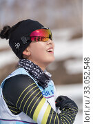 Купить «Portrait of smiling happy Korean sportswoman biathlete Lee Hyunju South Korea during Regional junior biathlon competitions East of Cup», фото № 33052548, снято 13 апреля 2019 г. (c) А. А. Пирагис / Фотобанк Лори